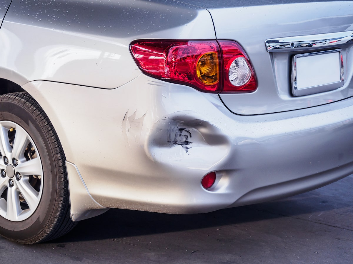 large car dent in need of professional dent removal