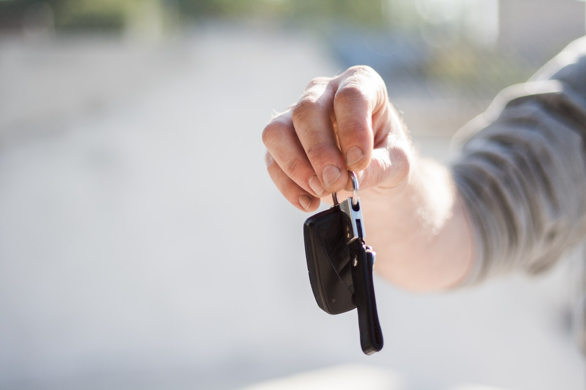 man handing keys to owner after repairing vehicle