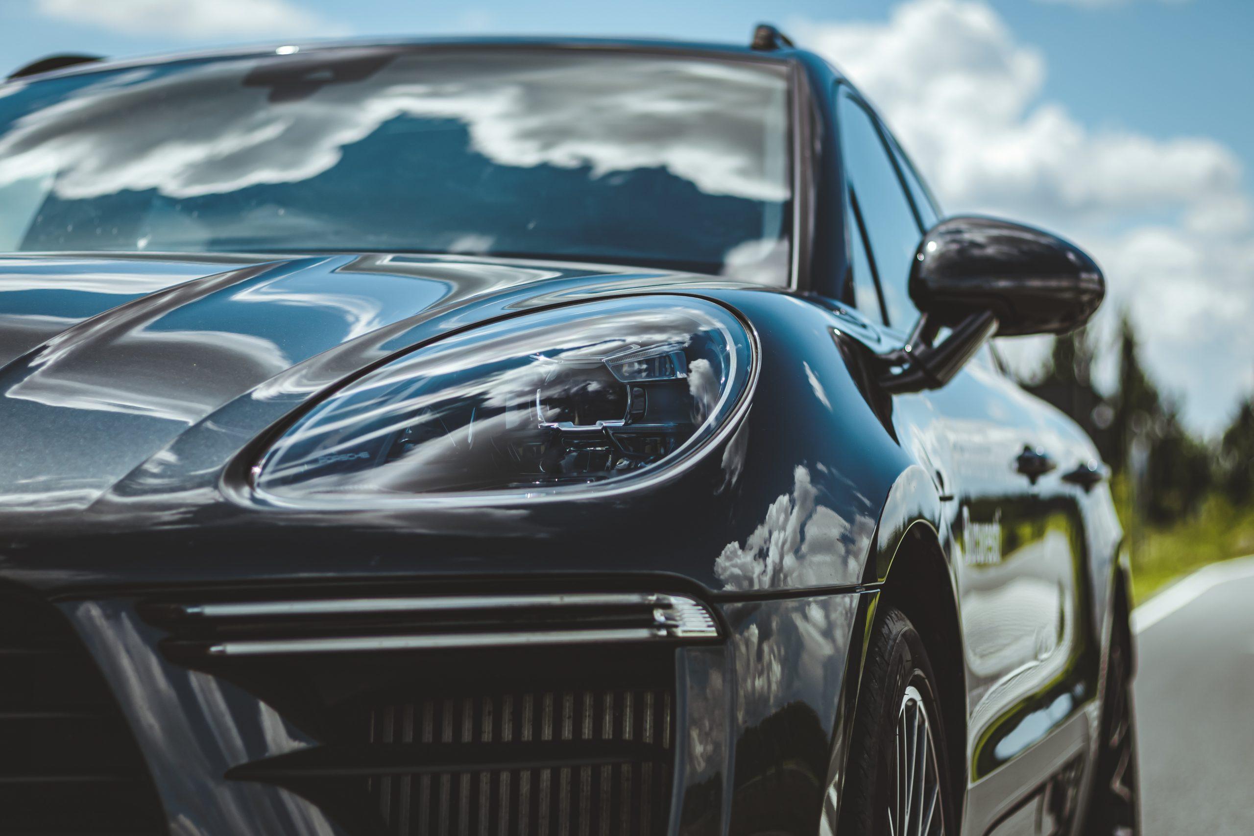 shiny black porsche cayenne headlights